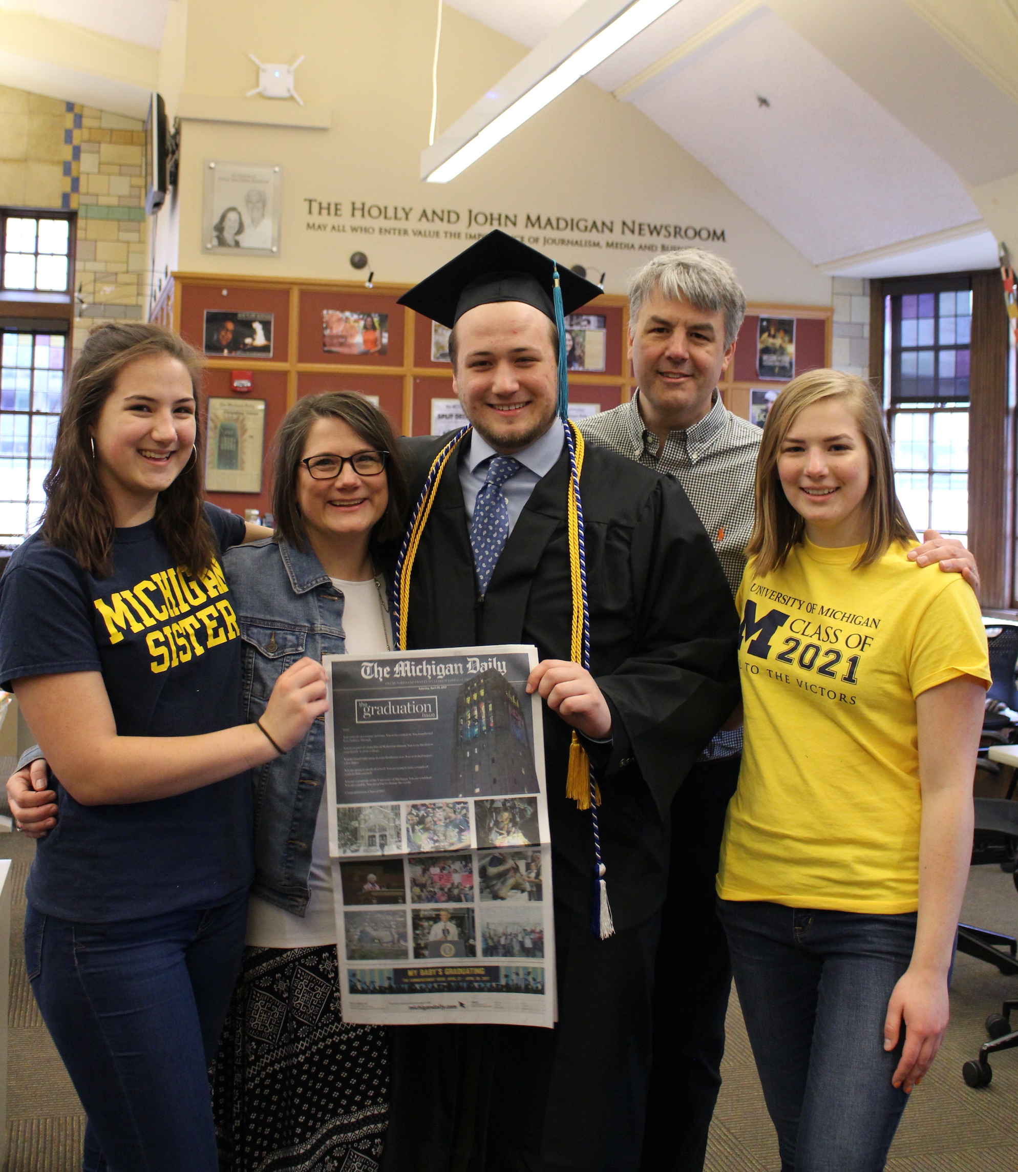 The Michigan Daily sports co-editor Max Bultman and his family celebrate his graduation